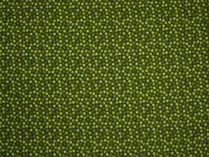 Grön med många Prickar